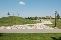 The park revitalization prepared by Brown+Storey Architects integrated an existing 'toboggan hill' into the park's path and occupation system, and recycled concrete from an old public swimming pool as a ceremonial path.